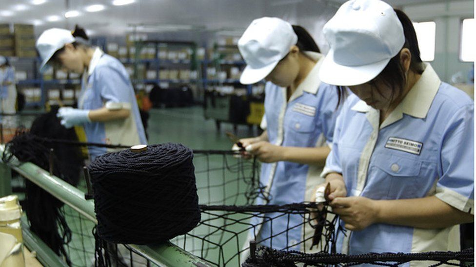 Employees knit knotless nets during processing at a Nitto Seimo Co factory in Fukuyama, Hiroshima (06 September 2016)