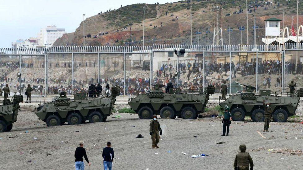Spanish armoured vehicles facing migrants at Ceuta border, 18 May 21