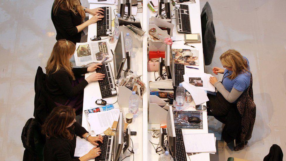 workers at desks