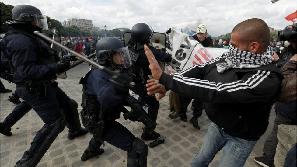 Masked youths and French police clash during a demonstration in Paris as part of nationwide protests against plans to reform French labour laws, France, June 14, 2016.