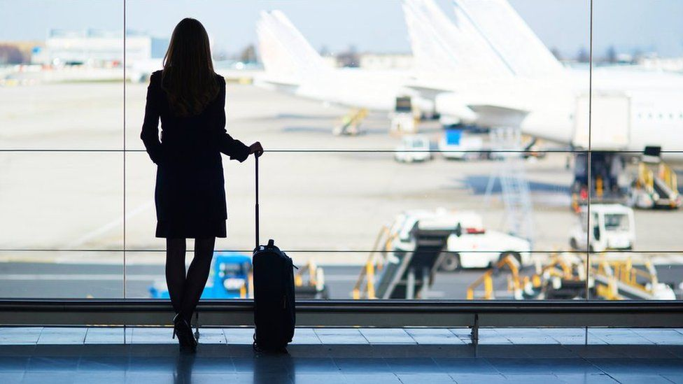woman waiting for aeroplane