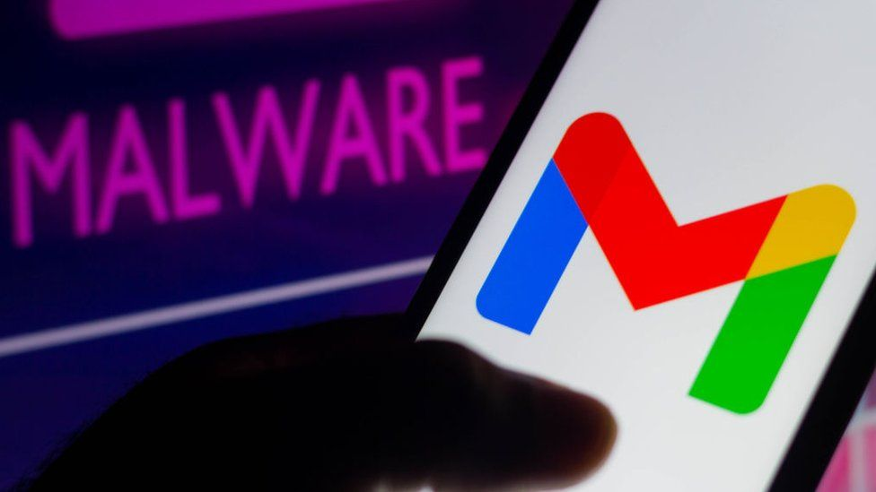 Illustration of gmail logo on a phone and neon script reading malware