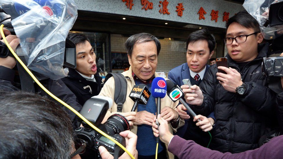 Bookseller Lee Bo, centre, speaks to media near his home in Hong Kong Friday, March 25, 2016