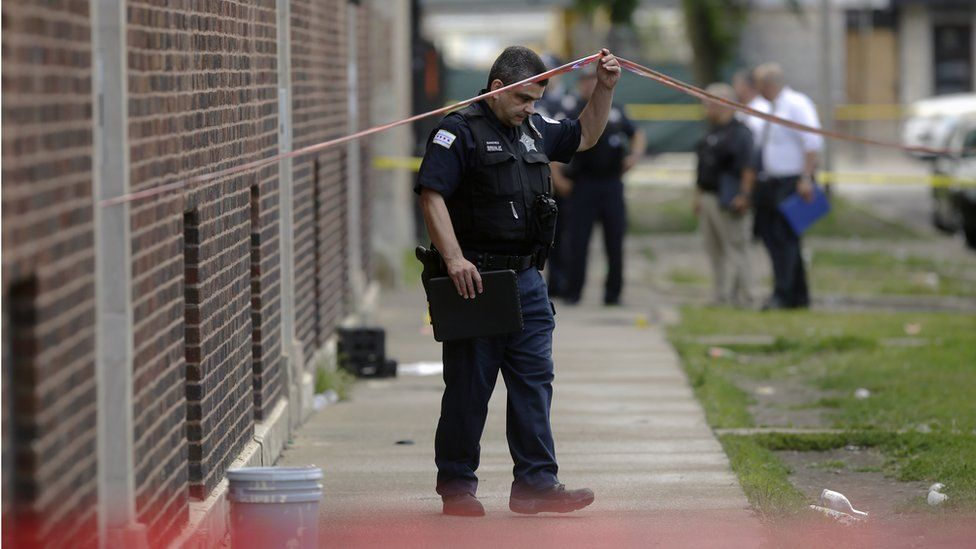 Chicago Police officers and detectives investigate a shooting where multiple people were shot on Sunday, August 5, 2018 in Chicago, Illinois