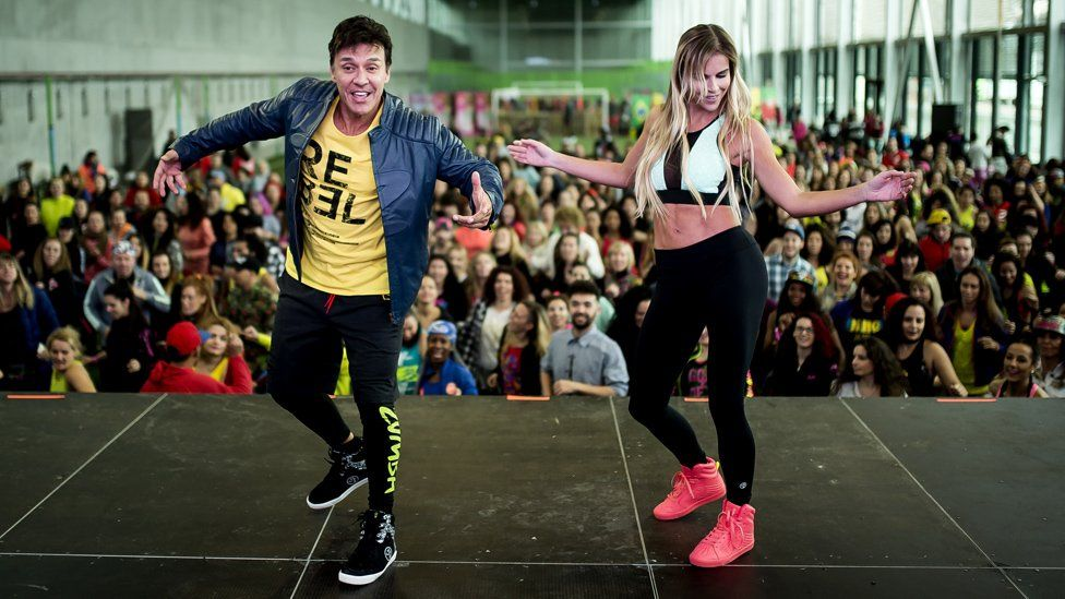 Beto Perez dancing at a Zumba event in Spain