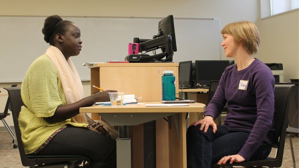 Nyamal Dei exchanges stories with newly elected Moorhead City Councilwoman Sara Watson Curry