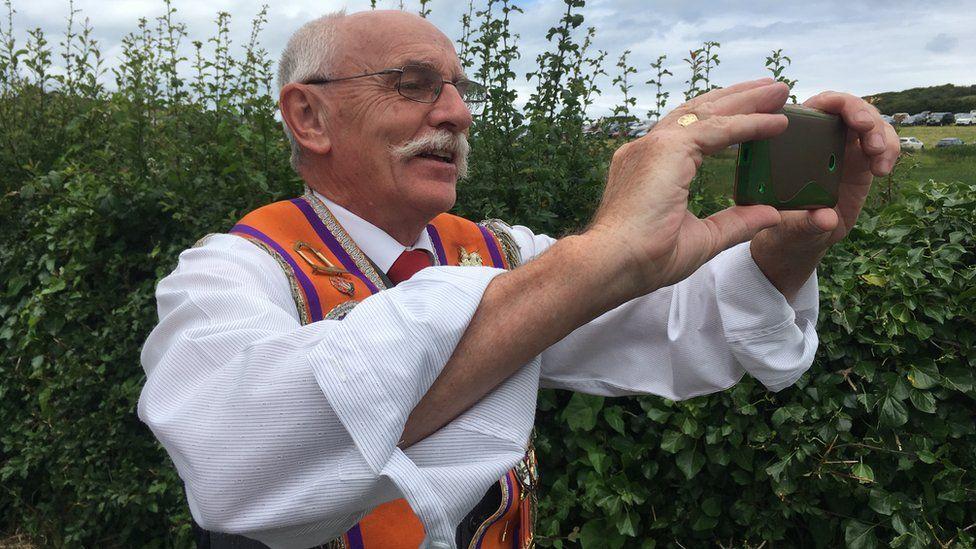 An Orangeman takes a selfie