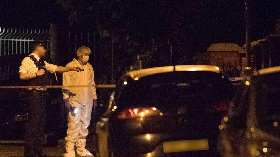 Police at the scene of an explosive device attack on the west Belfast home of former Sinn Féin president Gerry Adams.