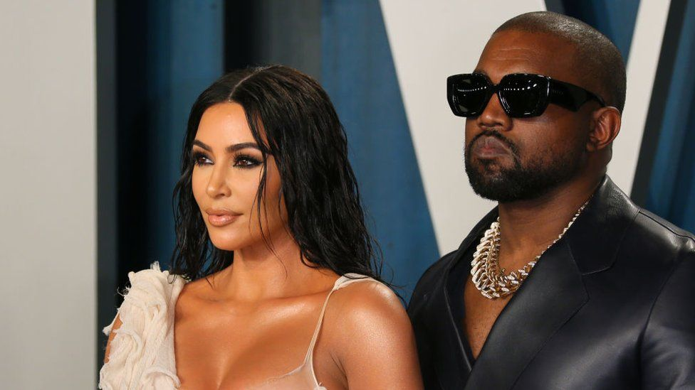 US media personality Kim Kardashian (L) and husband US rapper Kanye West attend the 2020 Vanity Fair Oscar Party