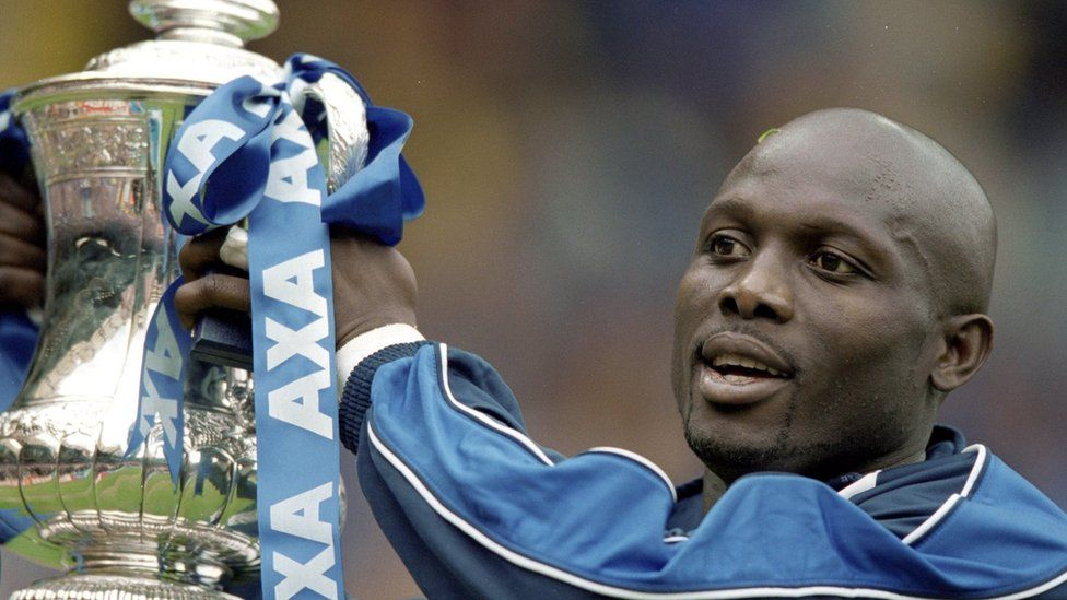 20 May 2000: George Weah of Chelsea lifts the FA Cup after the final against Aston Villa at Wembley Stadium in London.