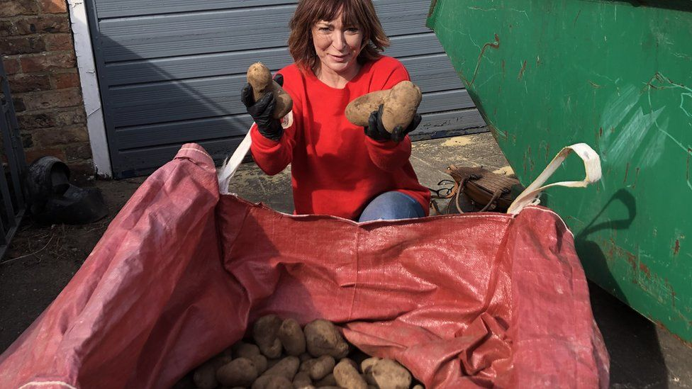 Susan Herdman holding potatoes
