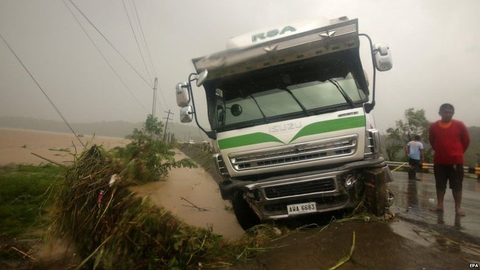 A vehicle is stuck on a roadside in the town of Piddig, Ilocos Norte province 22/08/2015