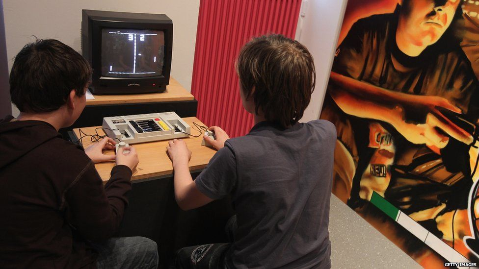 Visitors try out Pong, one of the first, commercially successful home computer video games, at the Computer Game Museum - January 2011