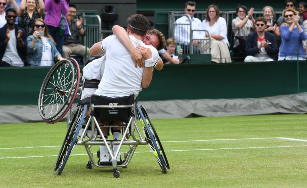 Alfie Hewett and Gordon Reid celebrate winning the final of the men's wheelchair doubles at Wimbledon 2016