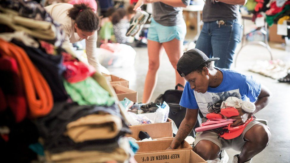 People sort through donated clothes at the Lake Charles Civic Center in Lake Charles, Louisiana on August 31, 2017.