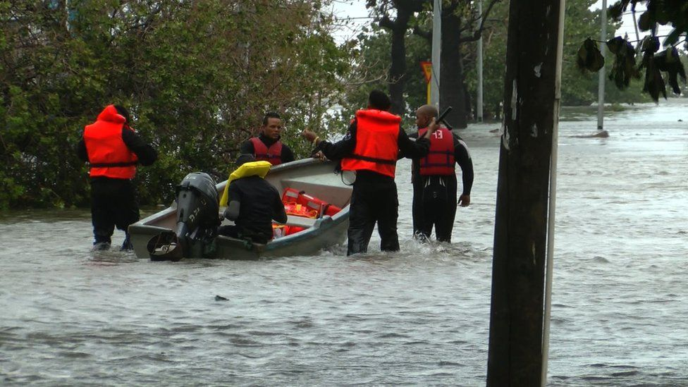 Rescuers had to use boats to rescue to rescue the elderly from their homes in Vedado