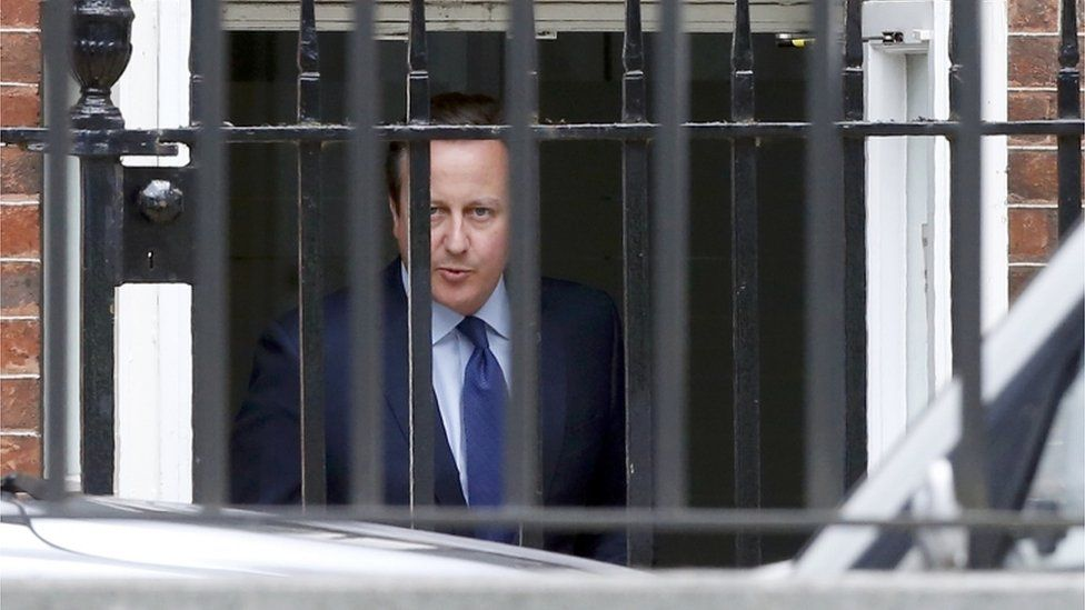 David Cameron leaves Downing Street through a rear entrance after his final cabinet meeting
