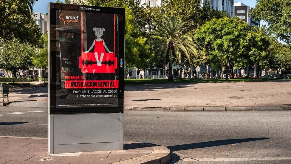 A poster of the campaign against female genital mutilation is seen in Barcelona.