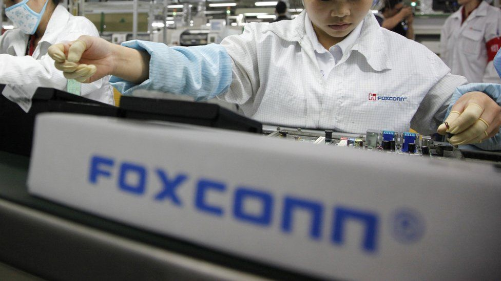 File photo of someone assembling in Foxconn factory