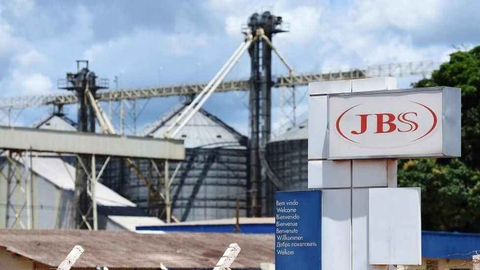 This file photo taken on March 17, 2017 shows a view of the JBS-Friboi Logo at the chicken processing plant entrance, in Samambaia, Federal District, Brazil.