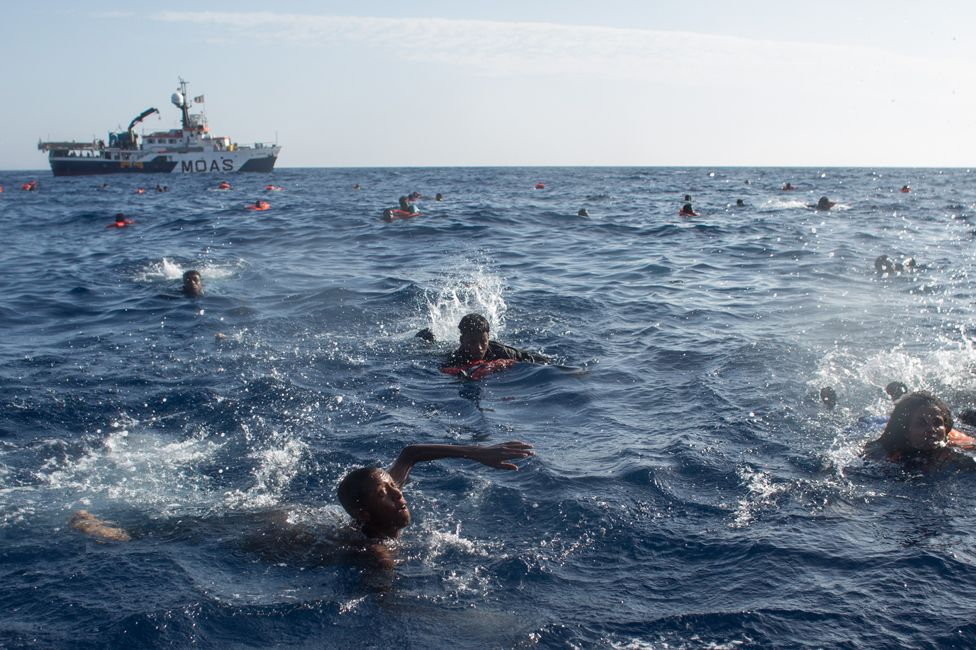 Migrants swimming in the Medterranean after their boat capsized near Lampedusa in May 2017