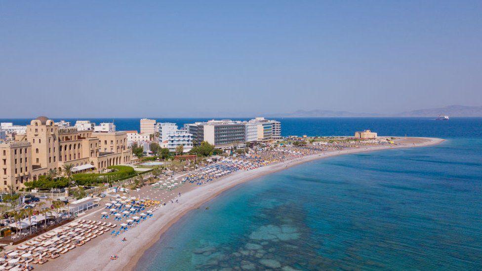 Image shows a beach in Rhodes