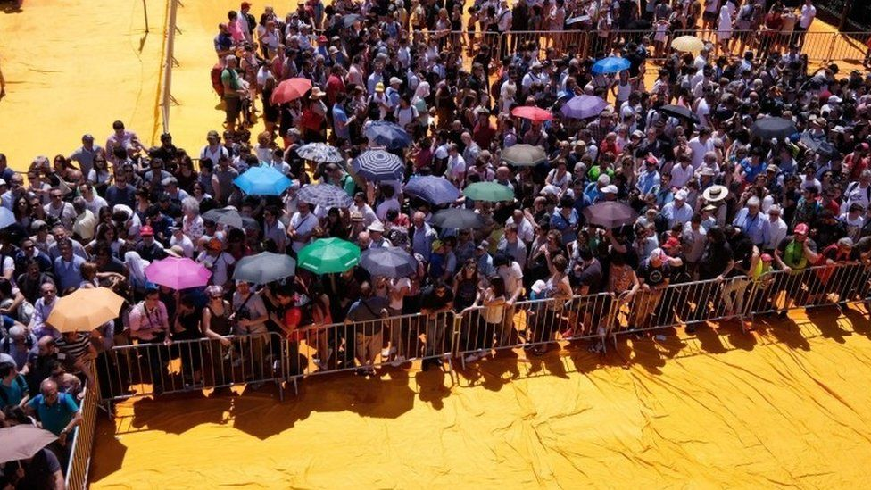 People queue to walk on the Floating Piers installation 18/06/2016
