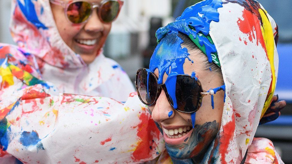 """Paint-covered revellers take part in the traditional """"Jouvert"""" opening parade"""