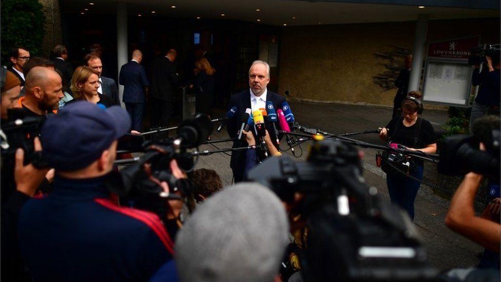 Markus Pfueller, head lawyer for Volkswagen, speaks to the press
