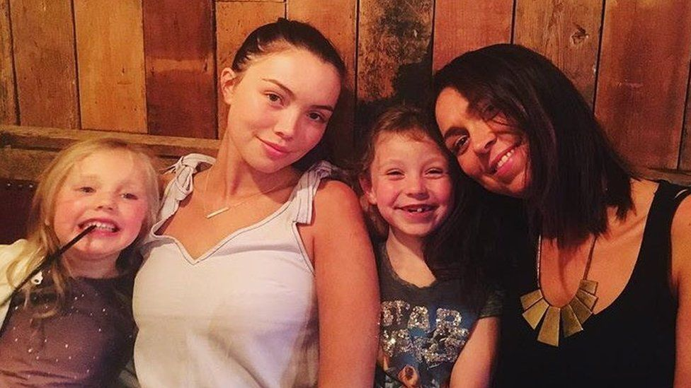 Lauryn pictured with her younger sisters and mother