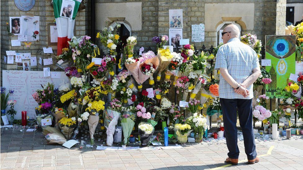 Flowers and other tributes outside the nearby Notting Hill Methodist Church