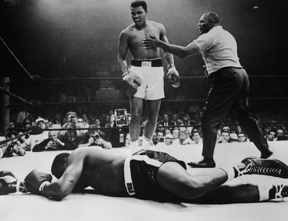 Sonny Liston lies out for the count after being KO'd in the first round of his return title fight by world heavyweight champion Muhammad Ali, Lewiston, Maine, May 25, 1965