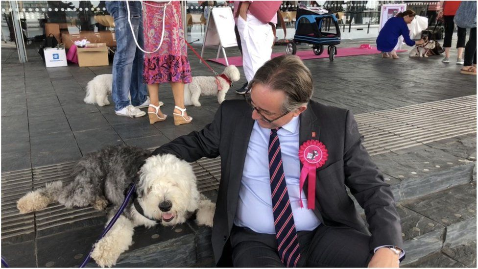 Mick Antoniw AM with one of the campaigner's dogs