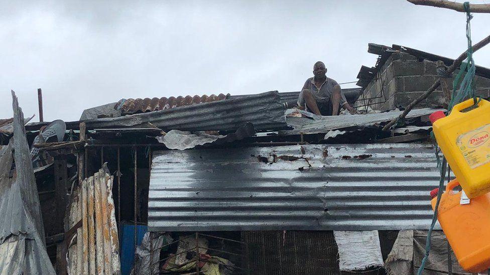 Man mending roof