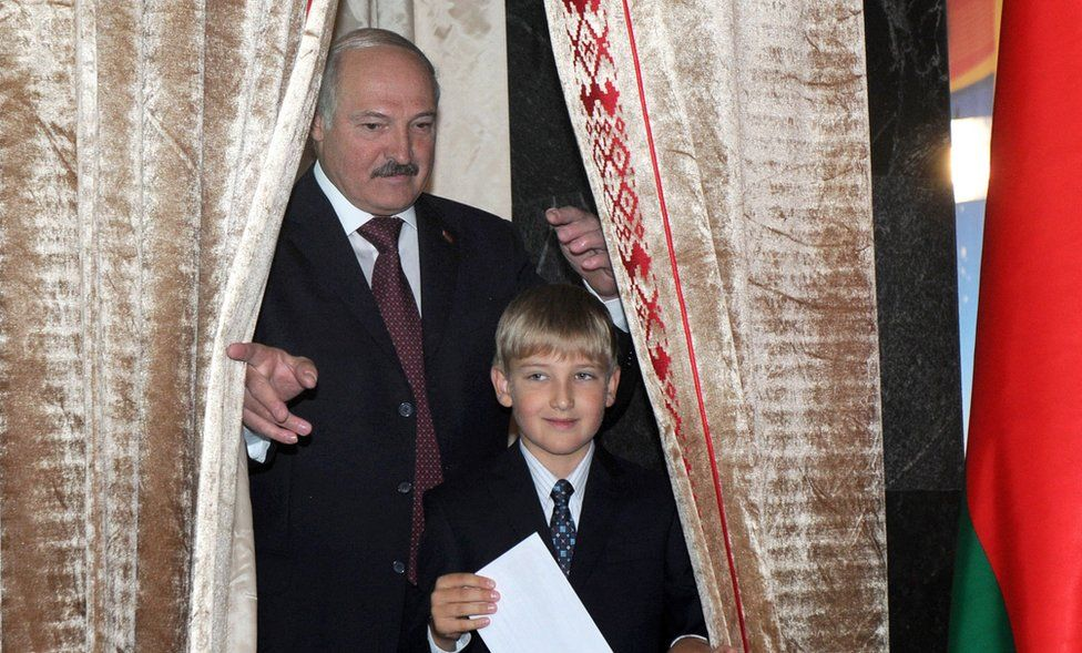 Belarus's President Alexander Lukashenko (left) stands with his son Kolya prior to cast his ballot on September 23, 2012 in Minsk