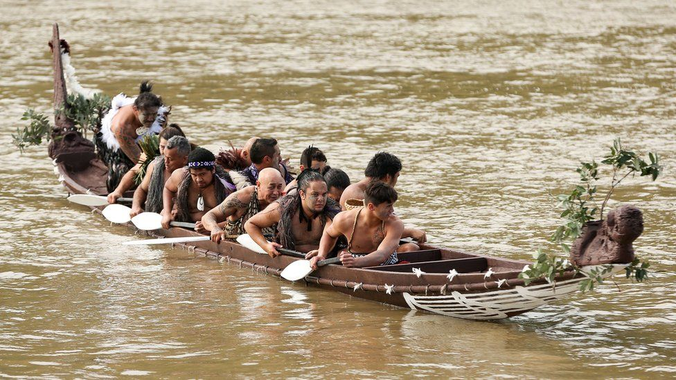 Members of the crew rest their paddles after paddling with Prince Harry on the Whanganui River during a visit to Putiki Marae on 14 May 2015 in Wanganui, New Zealand.