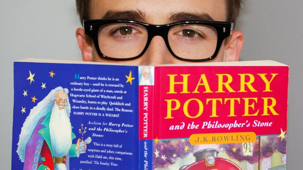 Reader with first Harry Potter book