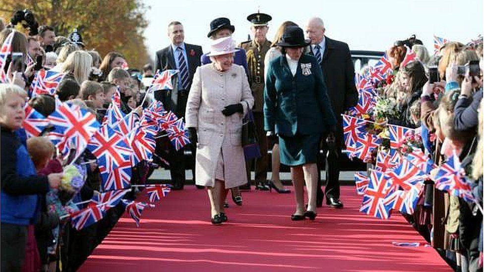 The Queen arriving