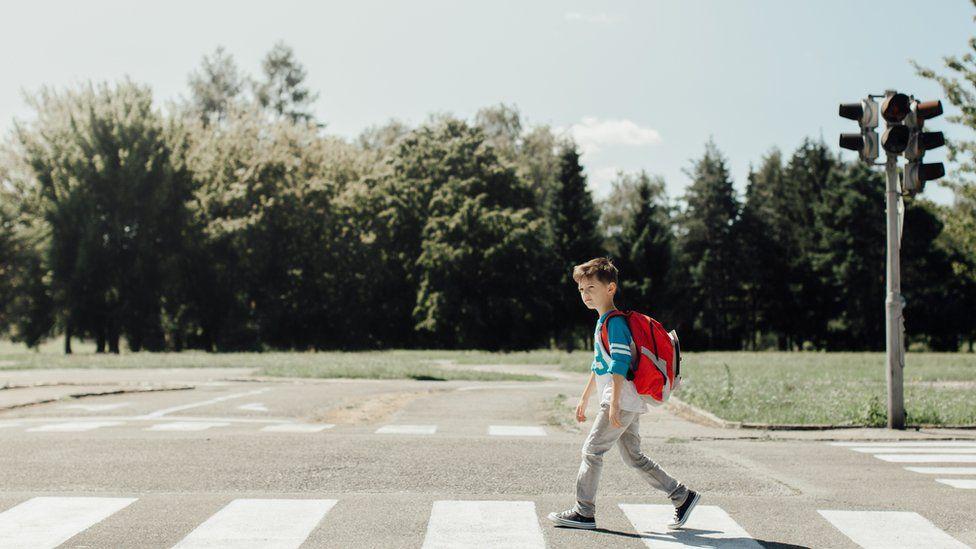 a boy walking to school