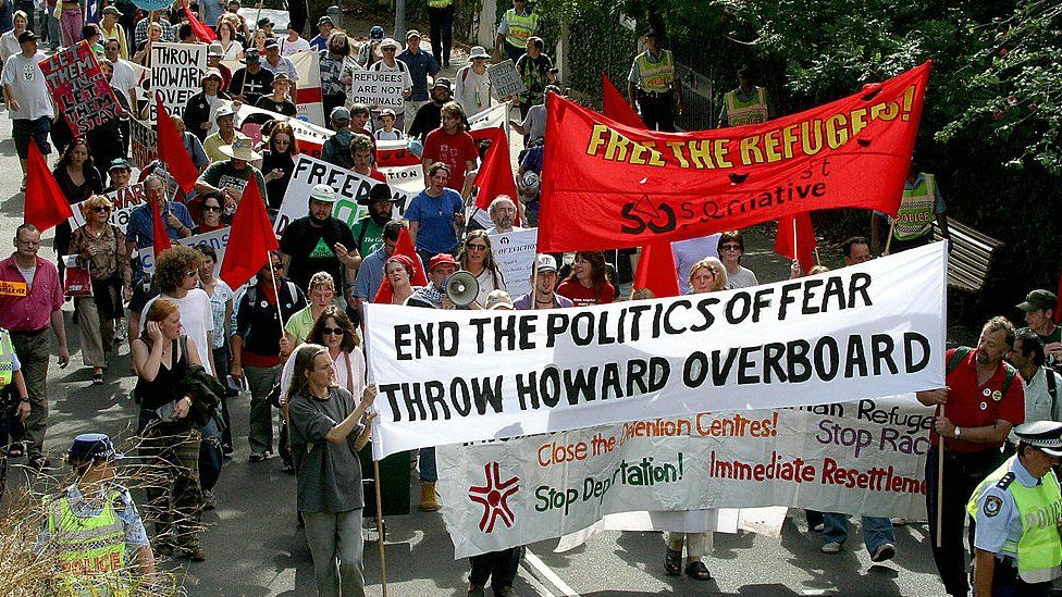 """People protest in Sydney over the """"children overboard"""" affair"""