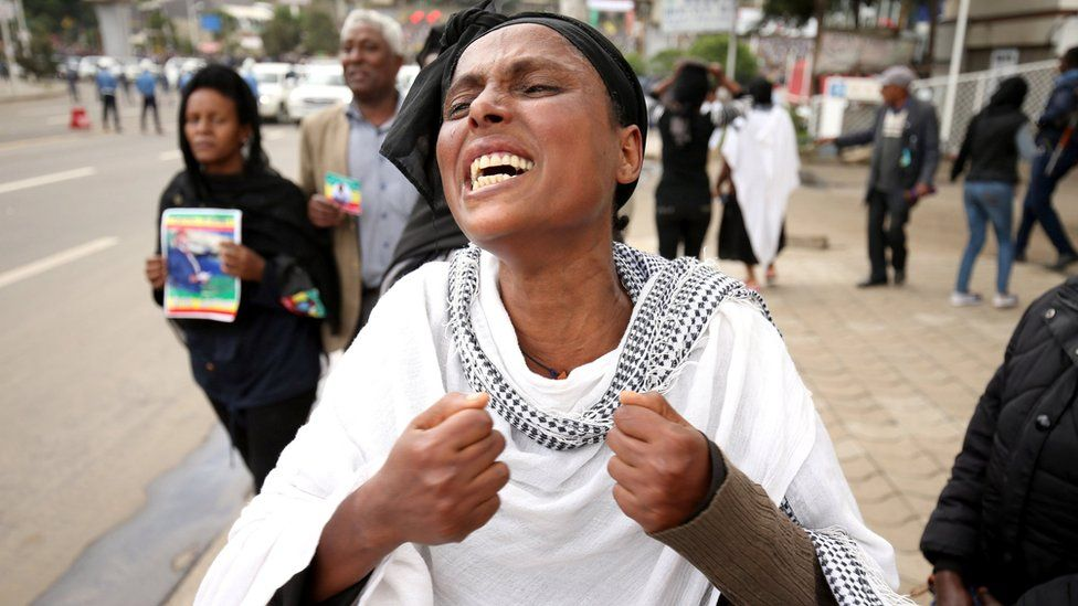 A woman reacts during the funeral ceremony of Simegnew Bekele