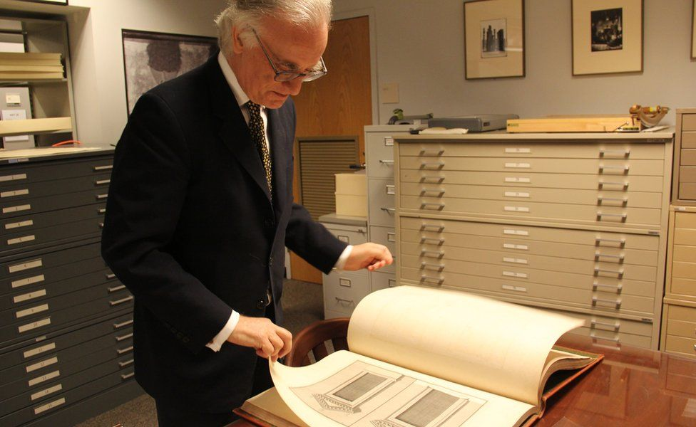 Julian Raby looks at a copy of The Ruins of Palmyra in the Freer's archive