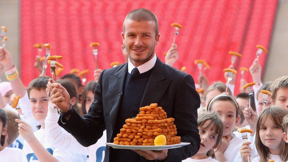 Beckham with a plate of fish fingers