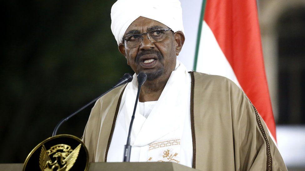 Sudan's President Omar al-Bashir delivers a speech to the nation at the presidential palace in the capital Khartoum, 22 February 2019