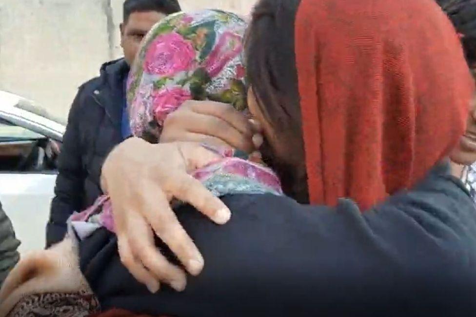Farah hugs her sister outside court