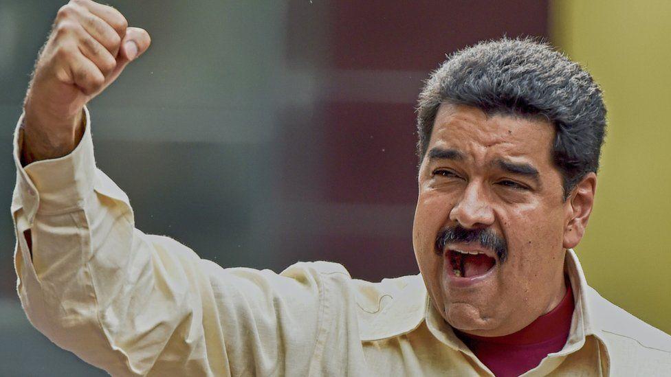 Venezuelan President Nicolas Maduro gestures during a rally in Caracas on April 19, 2016.