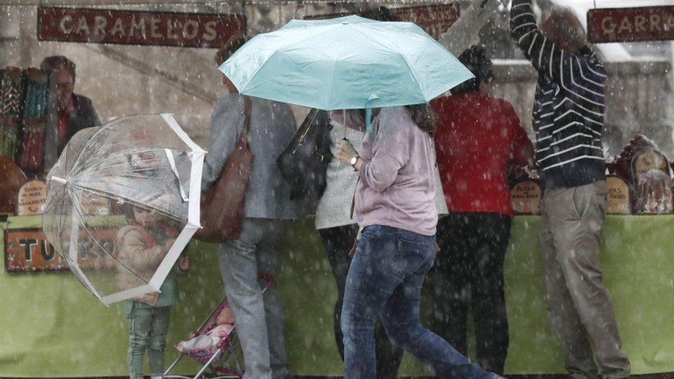 Heavy rainfall in a market in Pamplona in Spain