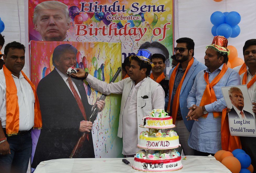Indian right-wing Hindu activists hold a celebration to mark the 70th birthday of US Republican presidential candidate Donald Trump in New Delhi on June 14, 2016.