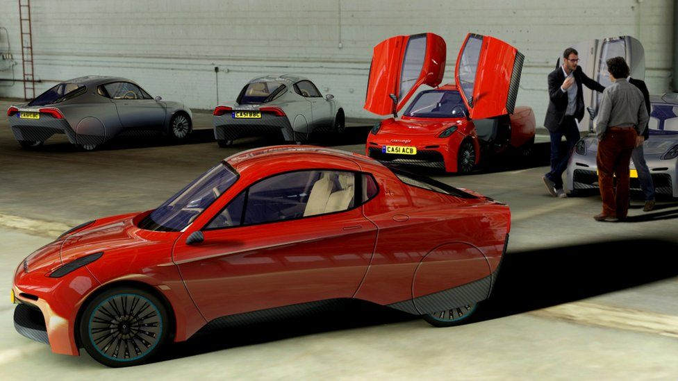 Riversimple Rasa cars in garage - with people talking in the rear of the picture