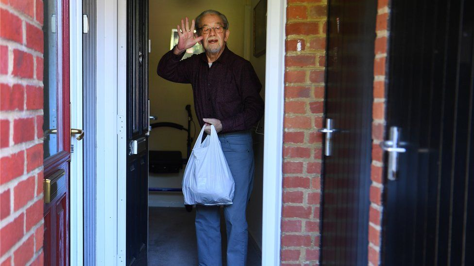 An elderly man receives urgent food supplies from Bucks Angels C-19 Community Group in High Wycombe, Buckinghamshire, Britain, 25 April, 2020.